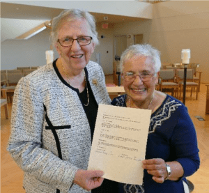 sisters posing with Covenant Agreement
